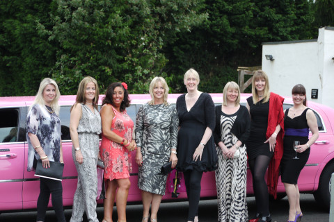 The hens having fun in the pink limo!
