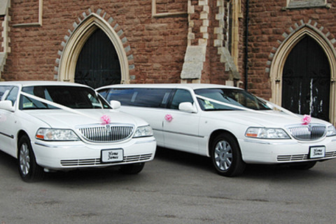 White Limos at the church on time!